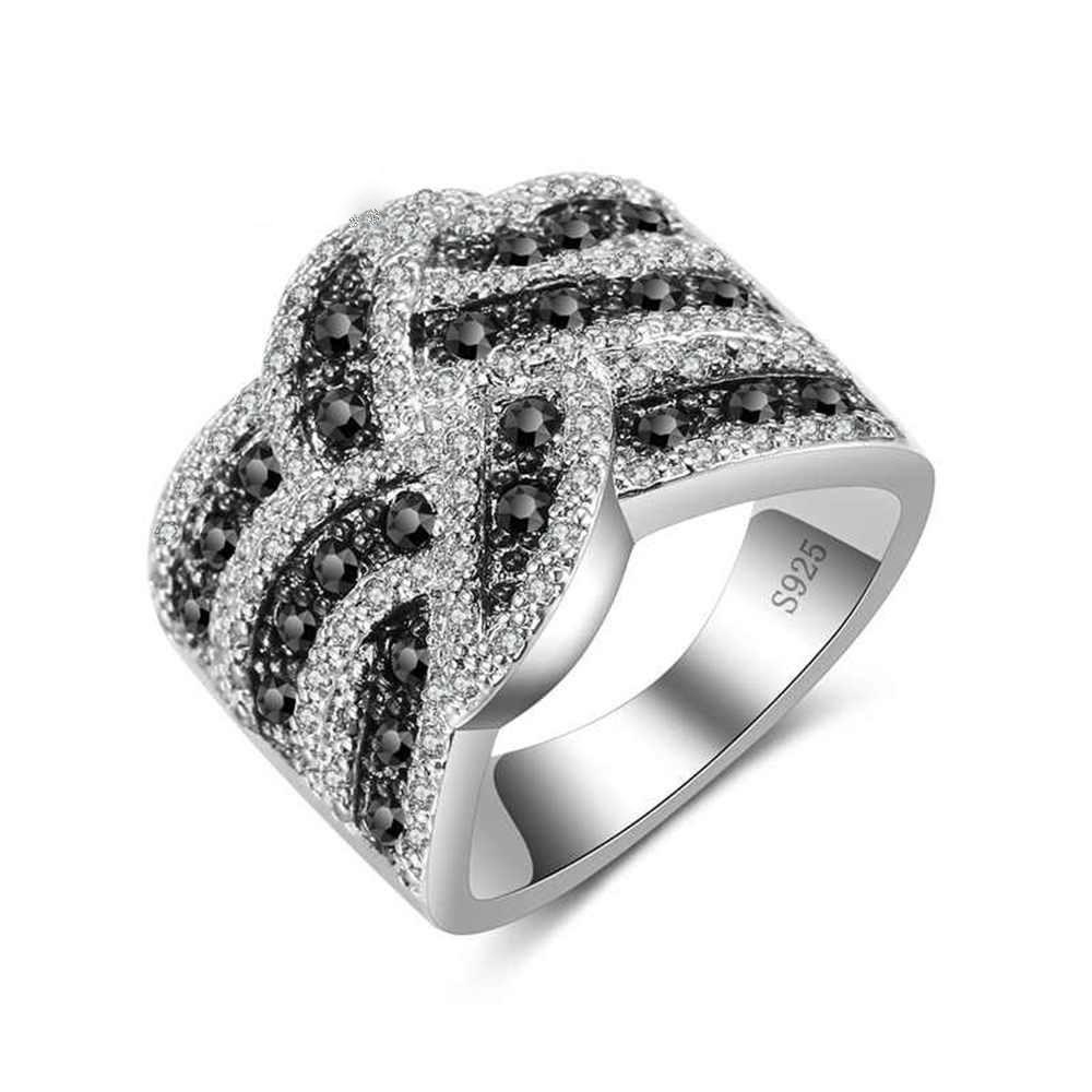 Anel banhado a prata com pedras zircão brancas e pretas
