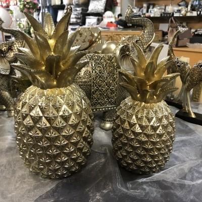 Ananás decorativo dourado